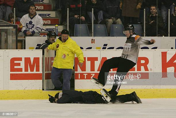 Towards the end of Primus Worldstars game against SC Bern a referee falls over an unconcious fan who jumped who jumped on the ice. The event was at...