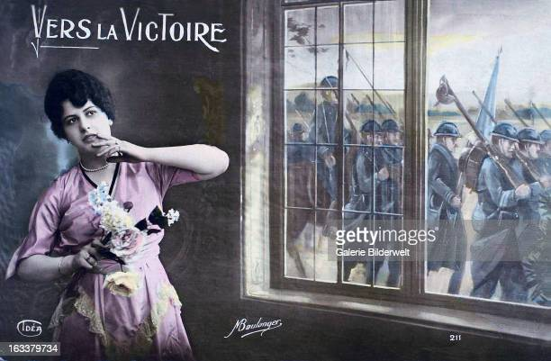 'Towards victory' 1915 A photomontage showing a woman in front of a window and a French army unit marching outside Western Front World War I France...