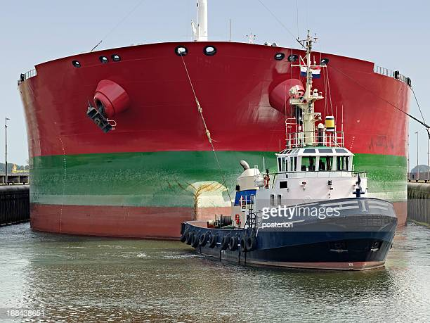 towed ship - tugboat stock photos and pictures