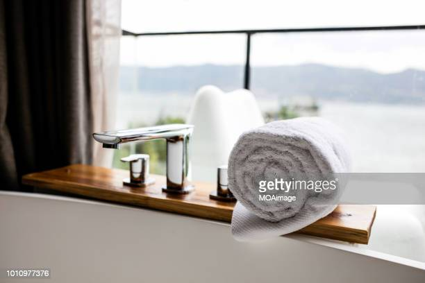 towel and water tap, bathroom close-up,yunnan,china - luxury hotel stock pictures, royalty-free photos & images