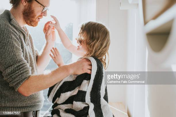 towel drying daughter - shielding stock pictures, royalty-free photos & images