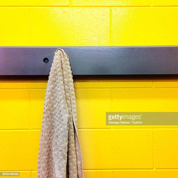 Towel Hanging From Hook On Wall