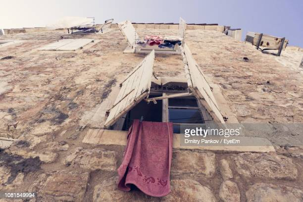 Towel Hanging From Old Building Window