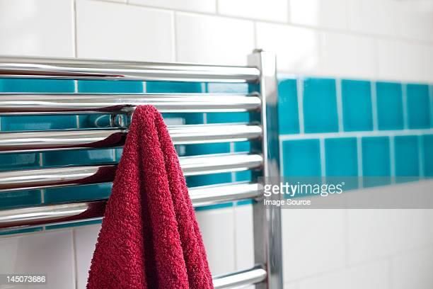 Towel hanging on a rail in bathroom