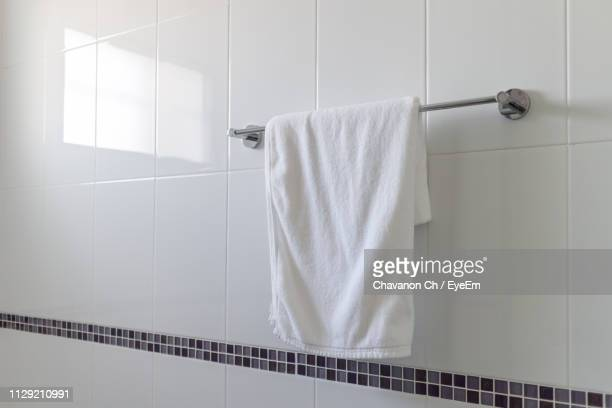 towel hanging on railing in bathroom - towel stock pictures, royalty-free photos & images