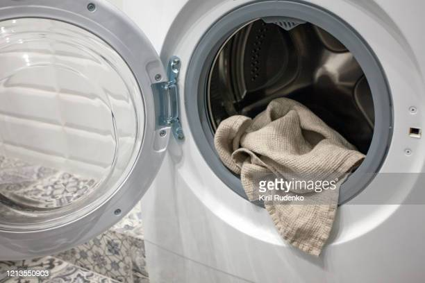 towel hanging out of a washing machine - tumble dryer stock pictures, royalty-free photos & images