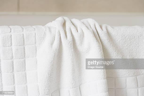 Towel on the edge of a bath