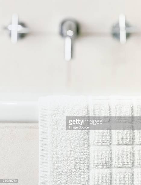 Towel on the edge of the bath