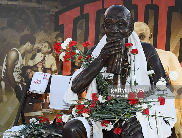 Towels and flowers are among items placed at a statue of Jerry Tarkanian outside the Thomas Mack Center at UNLV during a gathering of fans for the...