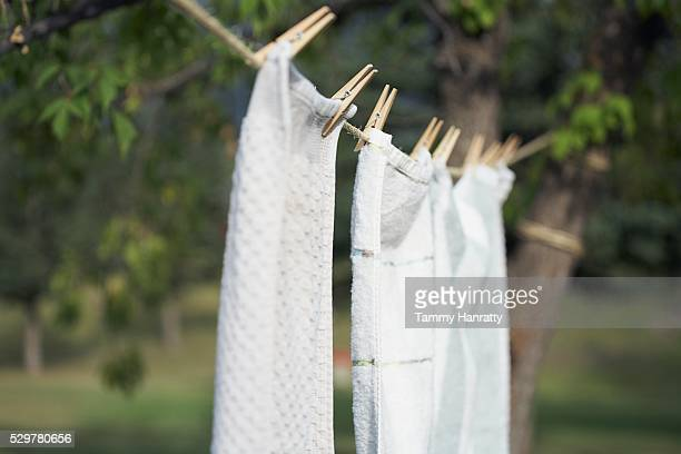 towels drying on clothesline - dish towel stock pictures, royalty-free photos & images