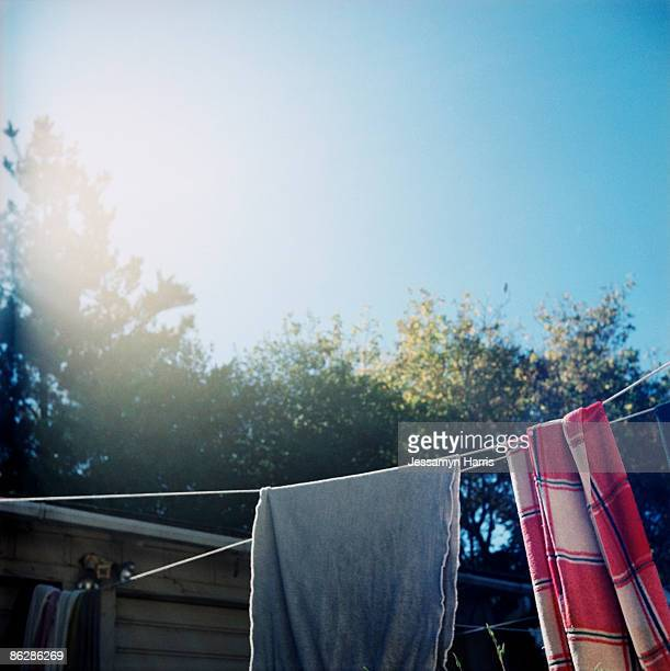 towels hanging on clothesline - jessamyn harris stock pictures, royalty-free photos & images