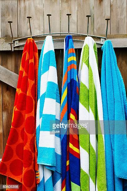 Towels Hanging on Wooden Door
