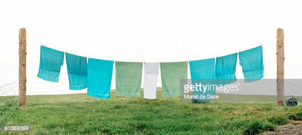 towels on drying line - clothesline stock pictures, royalty-free photos & images