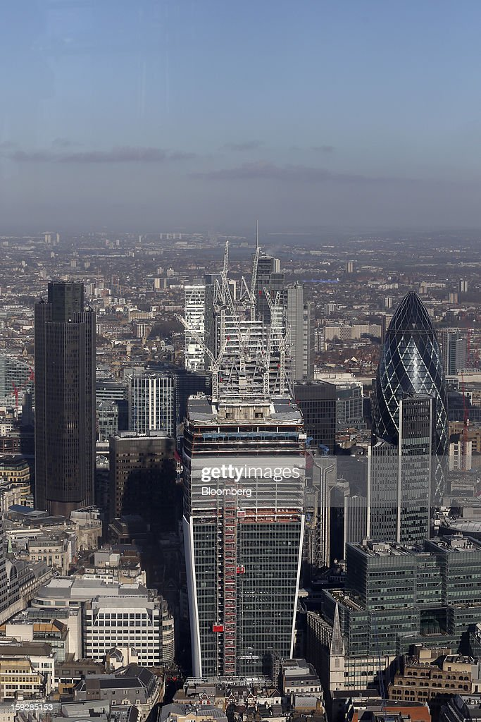 Tower 42, left, 20 Fenchurch Street, or the 'Walkie-Talkie', center, and the Swiss Re Insurance building, also known as 'the Gherkin', right, are seen from 'The View From The Shard', a series of viewing galleries near the top of the Shard tower in London, U.K., on Wednesday, Jan. 9, 2013. The Shard, which stands at 309.6 meters on London's South Bank, is owned by LBQ Ltd., which brings together the State of Qatar (the majority shareholder) and Sellar Property Group Ltd., with non-equity funding by Qatar National Bank. Photographer: Chris Ratcliffe/Bloomberg via Getty Images