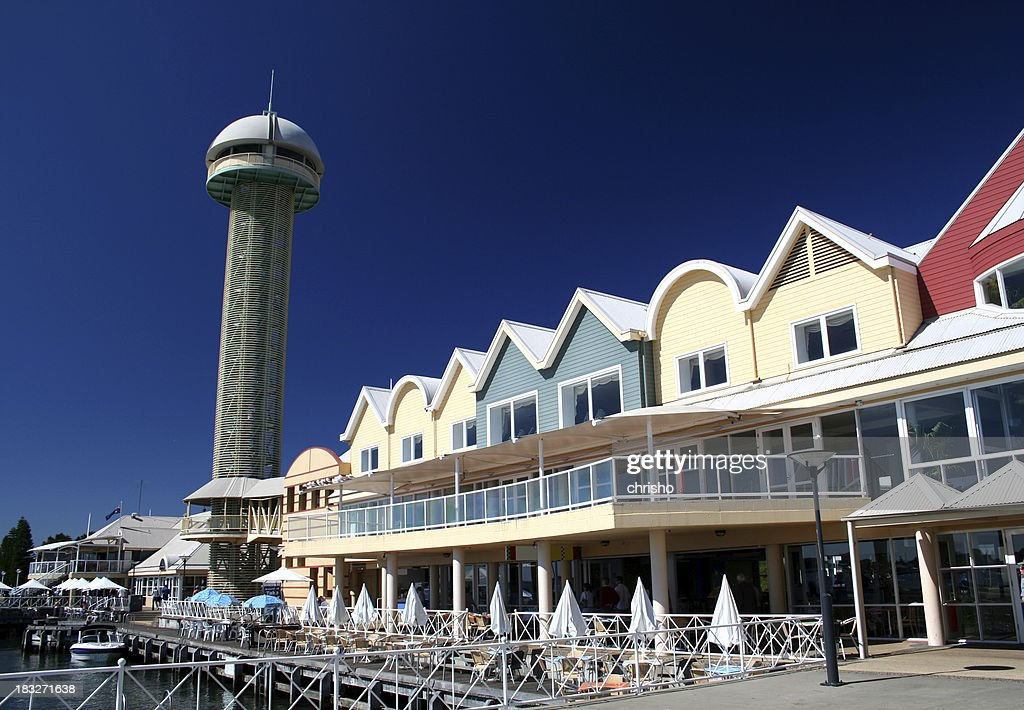 Tower and buildings at a wharf : Stock Photo