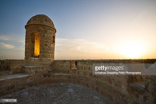 tower at the bahrain fort ruins - manama stock pictures, royalty-free photos & images