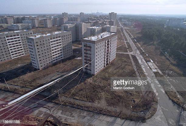 Tower blocks in the abandoned town of Pripyat evacuated after the Chernobyl disaster with the Chernobyl reactor on the horizon November 1995