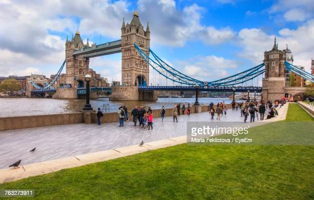 tower bridge against cloudy sky - river thames stock pictures, royalty-free photos & images