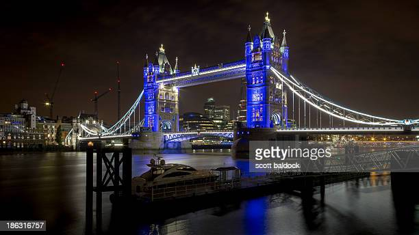 Tower Bridge and other famous landmarks lit up in blue to celebrate the birth of Prince George.London city architecture river thames prince George...