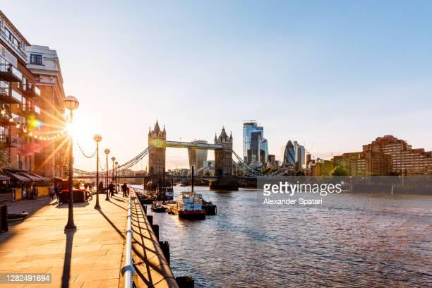 tower bridge and thames river at sunset, london, england, uk - ロンドン サウスバンク ストックフォトと画像