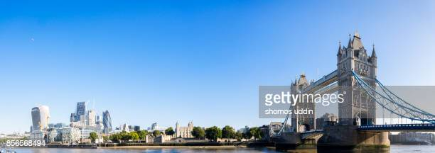 tower bridge and the city skyline across east central london - london bridge stock photos and pictures