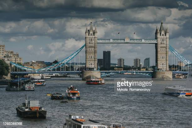 tower bridge and vessels around, on the beautiful cloudy day. - overcast stock pictures, royalty-free photos & images