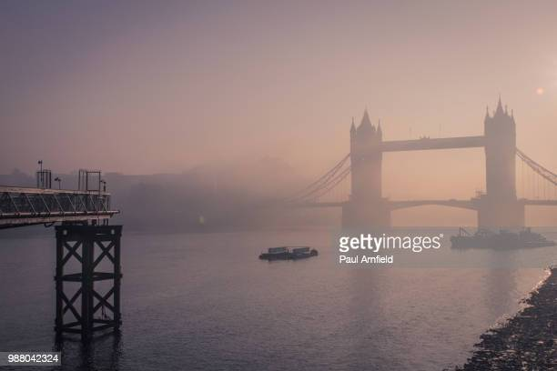 tower bridge at foggy dawn, london, england, uk - barge stock photos and pictures