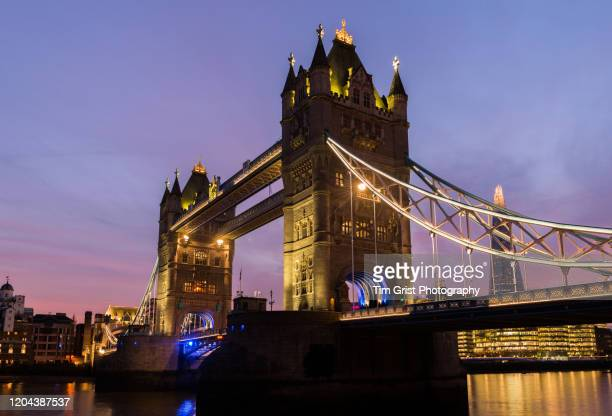 tower bridge at sunset, london, uk - tim grist stock pictures, royalty-free photos & images