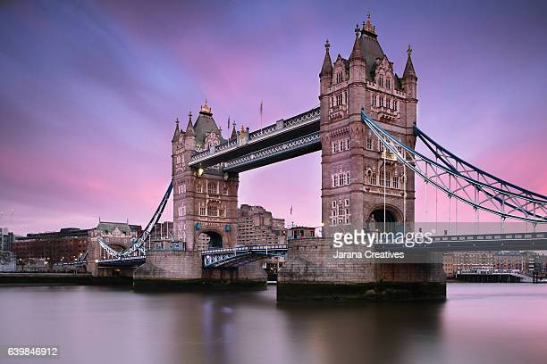 tower bridge at sunset. - tower bridge stock photos and pictures