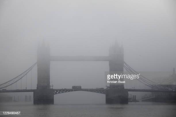 Tower Bridge covered in mist rising from the River Thames on 5th of November 2020, central London, United Kingdom. It is the first day of lockdown...