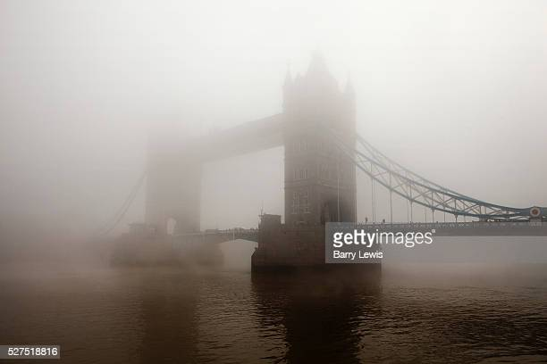 Tower Bridge emerging through London's smog on a day of record pollution due to a combination of traffic fumes relatively still weather and an influx...