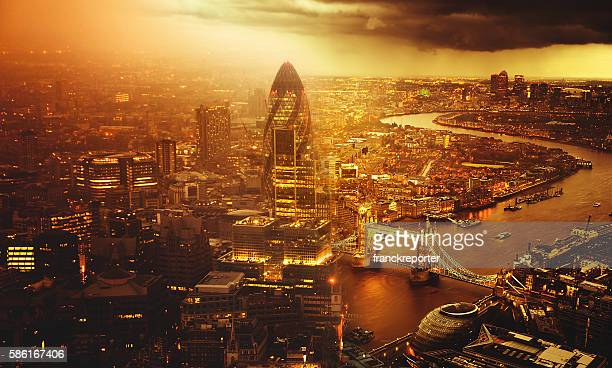 tower bridge helicopter aerial view in london - canary wharf stock photos and pictures