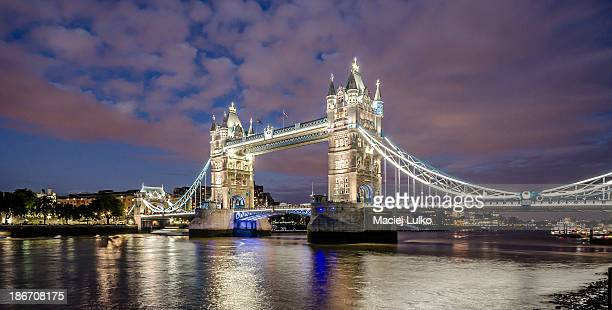 Tower Bridge, historic bridge and landmark of London seen from southbank of Thames at night.