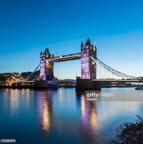 Tower Bridge Illuminated at Twilight in London United Kingdom