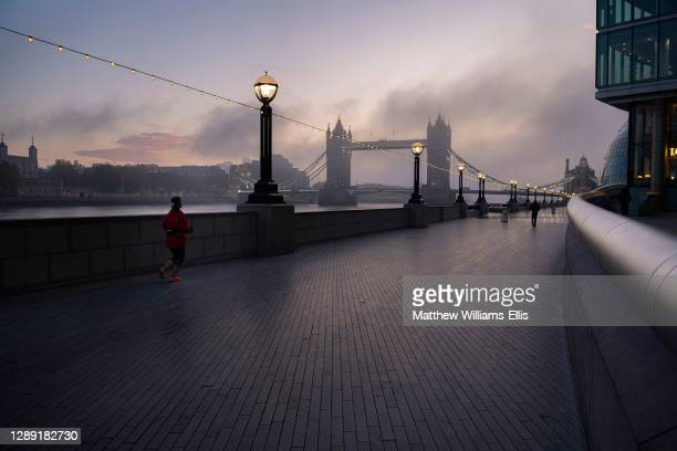 Tower Bridge in London with beautiful colourful sunrise, dramatic clouds and sky, showing iconic famous city skyline and landmark on day one of...
