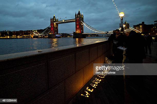 Tower Bridge is illuminated in the colours of the French Tricolore in tribute to the victims of the terrorist attacks in Paris on January 11 2015 in...