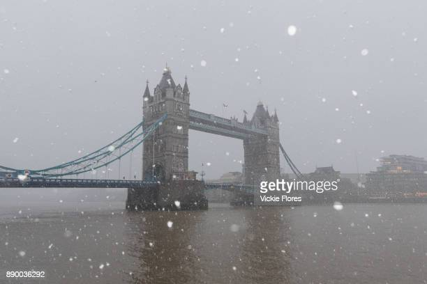 Tower Bridge is seen during a heavy snow shower on December 10th 2017 Much of the UK has been hit by heavy snow and The Met Office have issued a...