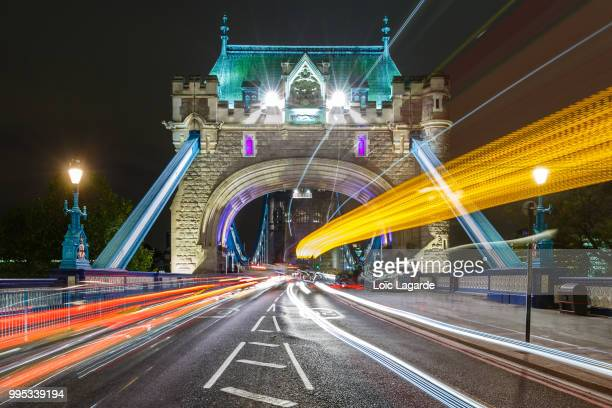 tower bridge light explosion in london - lagarde stock pictures, royalty-free photos & images