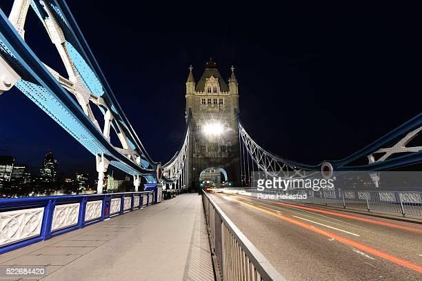 Tower Bridge lit up at night.