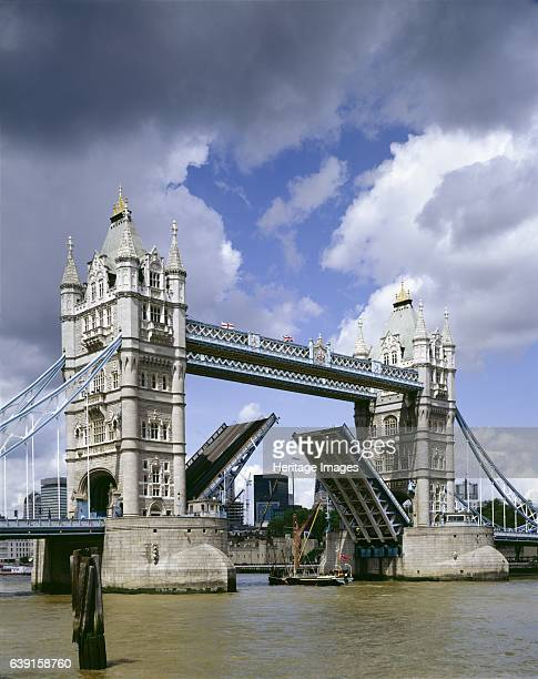 Tower Bridge, London, c1990-2010. The road bridge elevating to allow a sailing barge to pass beneath. A combined bascule and suspension bridge built...