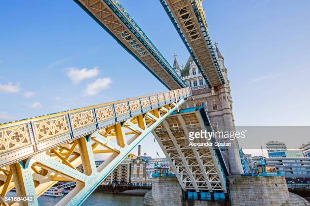 Tower Bridge opens over the river of Thames, London