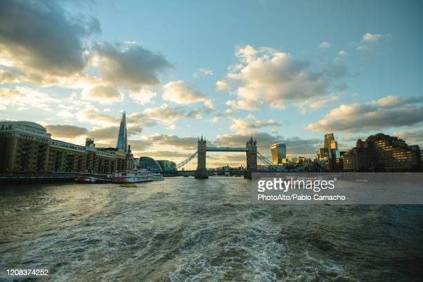 tower bridge over river thames - passenger craft stock pictures, royalty-free photos & images