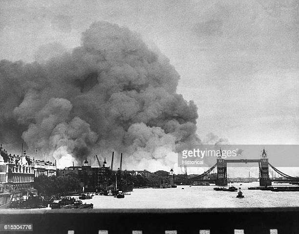 Tower Bridge stands out against a background of smoke and fires in London's dock areal during the first mass air raid on London September 7 1940