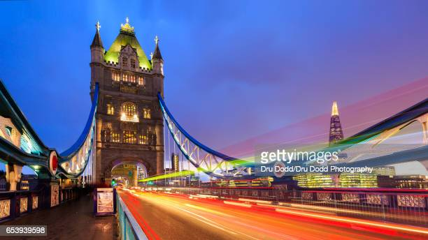 tower bridge traffic - london bridge stock photos and pictures