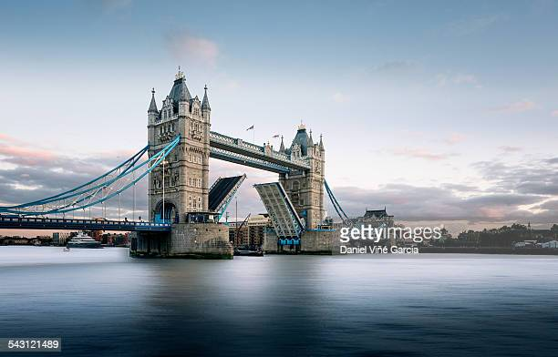 Tower bridge with bascules going up