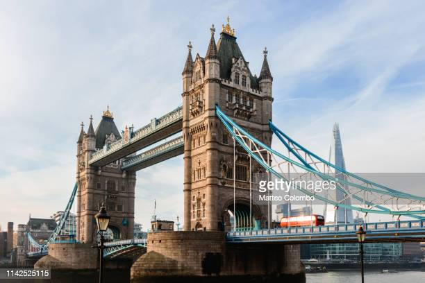 tower bridge with red bus and the shard, london, uk - double decker bus stock pictures, royalty-free photos & images