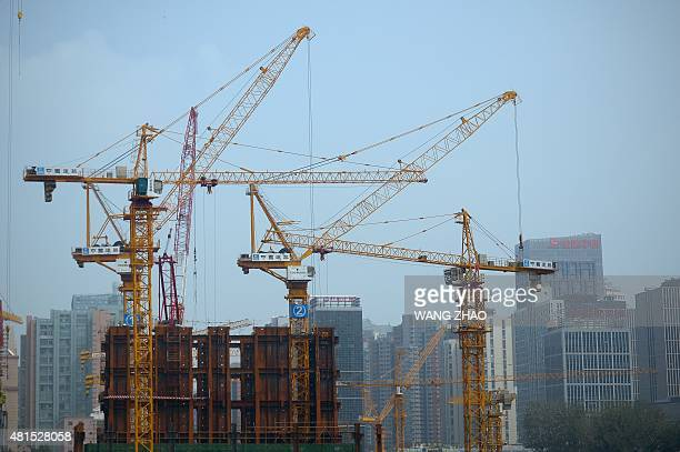 Tower cranes are seen at a construction site in Beijing on July 22 2015 Foreign investment into China rose eight percent in the first half of this...