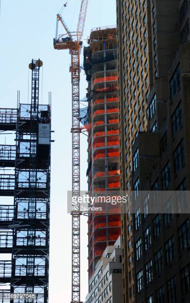 tower cranes at consruction site in midtown manhattan. nyc. - image stock pictures, royalty-free photos & images