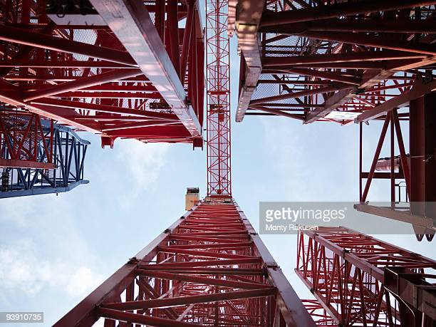 tower cranes from below - directly below stock pictures, royalty-free photos & images