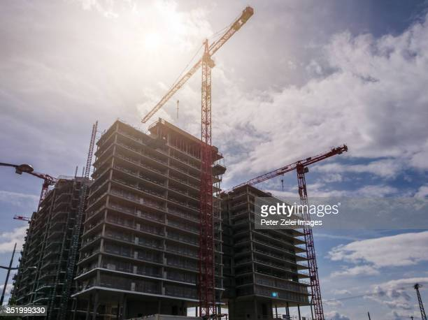 tower cranes in a construction site in vienna, austria - kran stock-fotos und bilder
